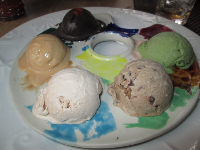 Ice Cream Palette: scoops of Dark Chocolate with Cayenne, Benguet Coffee with Choco Chips, Salted Caramel, Vanilla Cinnamon, Green Tea ice cream in an artist's palette saucer (P199)